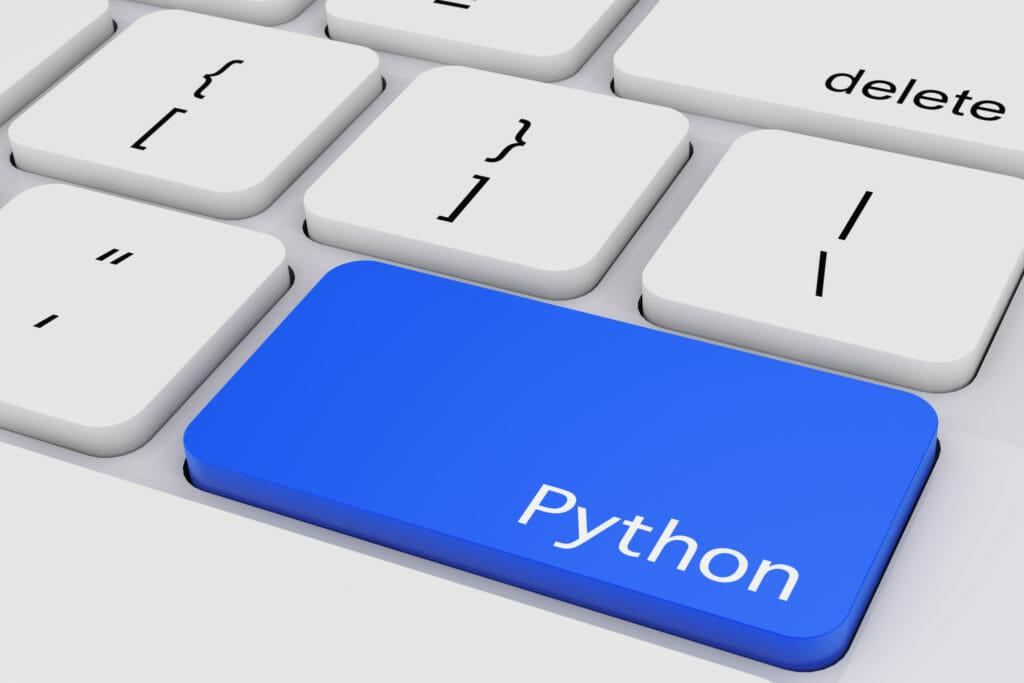 白いPCの青いPythonキー