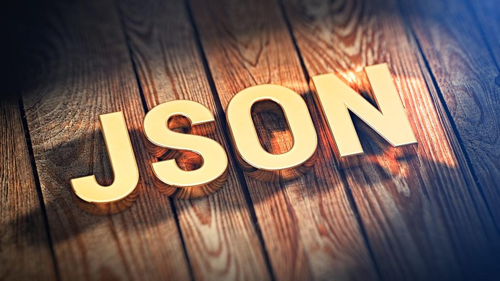 板の上に金色でJSON