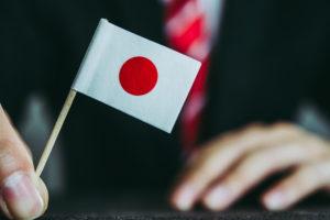 ビジネスマンと国旗