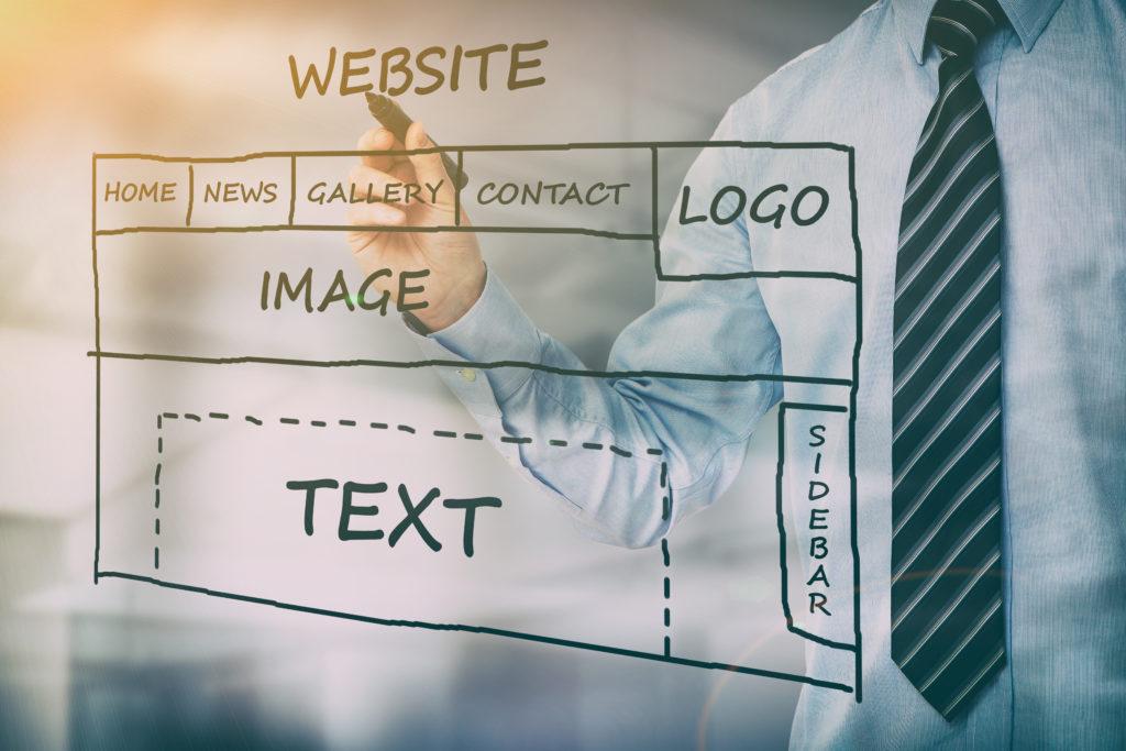 Designer drawing website development.